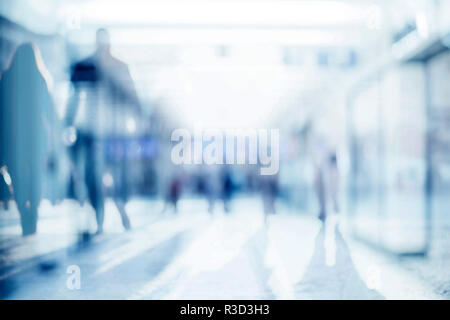 Abstract background of empty space with silhouettes of people passing by - Stock Photo