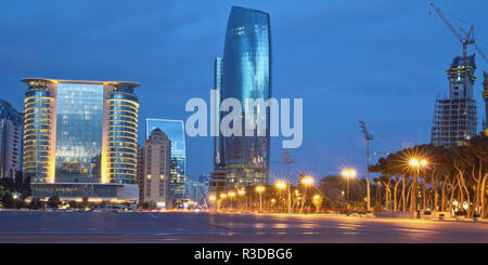 Azerbaijan, Baku at night Azadlig Square evening side. Platitude Freedom - Azadlig located on the shores of the Caspian Sea.Hotel Absheron Marriott .Neftchiler Avenue at night . Crane and new building - Stock Photo