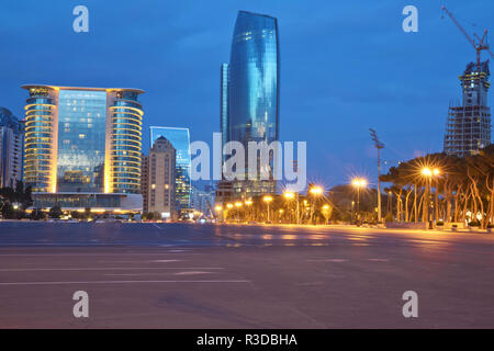 Azerbaijan, Baku at night Azadlig Square evening side. Platitude Freedom - Azadlig located on the shores of the Caspian Sea.Hotel Absheron Marriott . Neftchiler Avenue . Crane and new building Night - Stock Photo