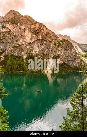 Lake Braies (also known as Pragser Wildsee or Lago di Braies) in Dolomites Mountains, Sudtirol, Italy - Europe. Romantic place with typical wooden boa - Stock Photo