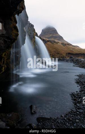 Kirkjufellfoss waterfalls at Snaefellness peninsula in Iceland - Stock Photo