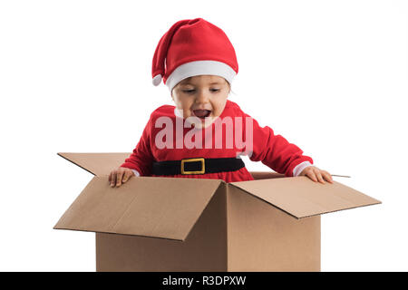 Happy little child in Santa hat in present cardboard, happy new year concept. - Stock Photo