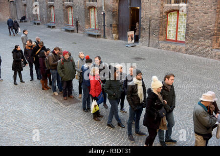 Toursts queueing to climb the Belfry Tower in Bruges (Brugge), Belgium - Stock Photo