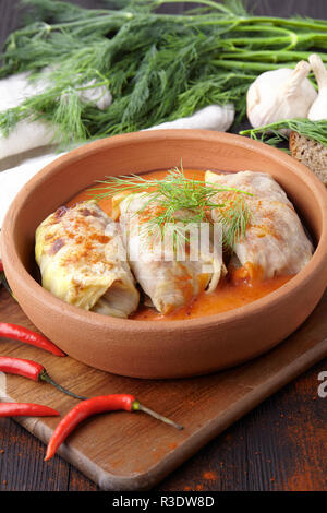 Stuffed cabbage leaves in tomato sauce on plate - Stock Photo