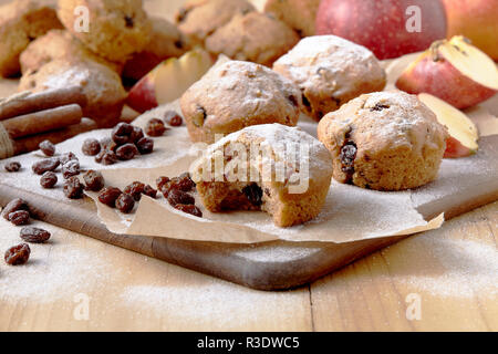 Traditional German Christmas pastry mini stollen on parchment paper on plank wood table - Stock Photo