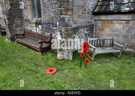 Remembrance Day poppies at St Michael and All Angels Church, Linton, North Yorkshire, UK - Stock Photo