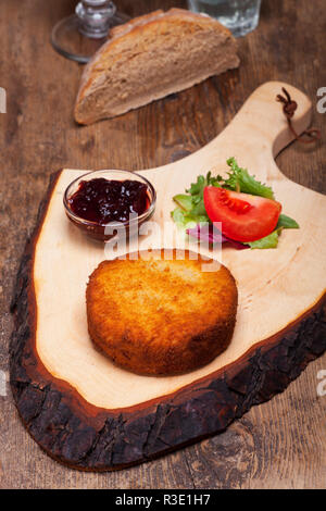 baked camembert on a wooden board - Stock Photo
