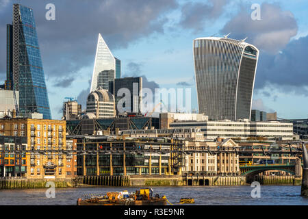 LONDON - NOVEMBER 15 : Modern skyscrapers in riverfront skyline of London, England against blue skies on sunny day on 15 November 2018 - Stock Photo