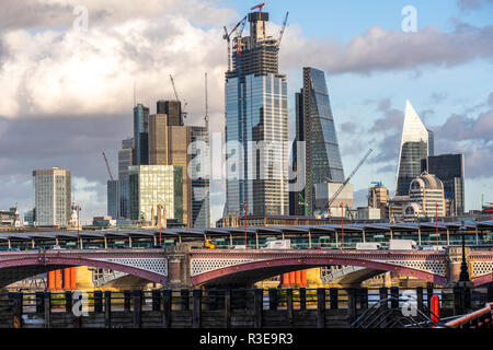 LONDON - NOVEMBER 15 : Skyscrapers under construction over Blackfriars Bridge in London, England on sunny day on 15 November 2018. - Stock Photo