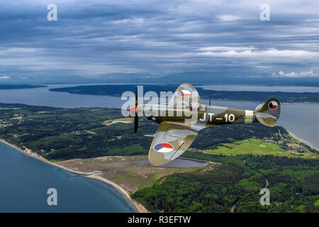 Supermarine 361 Spitfire in flight - Stock Photo