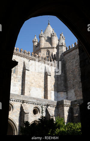 Evora's cathedral (the Se) viewed through arch in the cloisters to the Romanesque tower, Evora, Alentejo, Portugal, Europe - Stock Photo