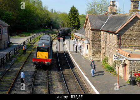 Passing loop at Highley Railway station, Shropshire, England, with steam and diesel locomotives passing each other. - Stock Photo