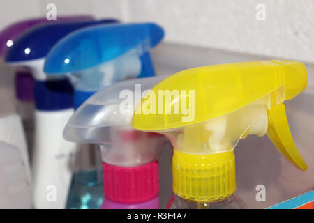 Cleaning products in different spray bottles - Stock Photo