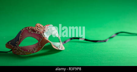 Carnival party. Venetian mask on green background, banner, copy space - Stock Photo