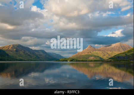 Pap of Glencoe and mountain scenery reflected in Loch Leven on quiet summer morning in Glencoe, Scotland - Stock Photo