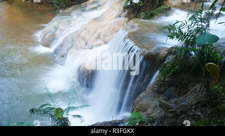 waterfall nature / beautiful stream waterfall background - river stream of small waterfall in blue water flow from mountain - Stock Photo