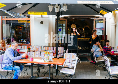 Lively terrace on Pilies g. Street, Vilnius, Vilnius County, Lithuania, Baltic states, Europe. - Stock Photo