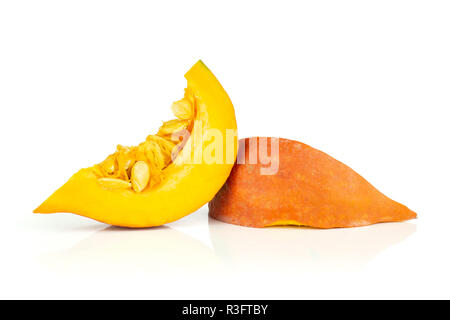 Group of two slices of fresh red kuri pumpkin hokkaido variety with seeds isolated on white background - Stock Photo