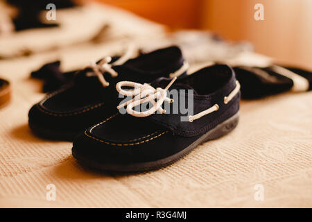 Clothing accessories for a child, suspenders, shoes and belt. - Stock Photo