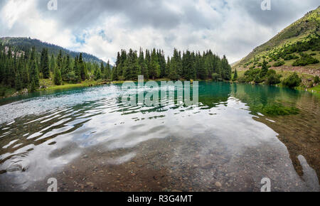 Mountain Saint lake in Gregory gorge in Kyrgyzstan, Central Asia - Stock Photo