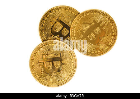 three golden bitcoin coin closeup with BIT symbol. Isolated on white studio background. Crypto-currency background of virtual money. - Stock Photo