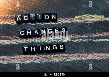 Action Changes Things - ACT on wooden blocks. Cross processed image with blackboard background. Inspiration, education and motivation concepts - Stock Photo
