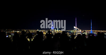 NEW YORK - UNITED STATES - 03 NOVEMBER 2017. People photograph the Manhattan's skyline from the Top Of The Rock Observatory at night. - Stock Photo