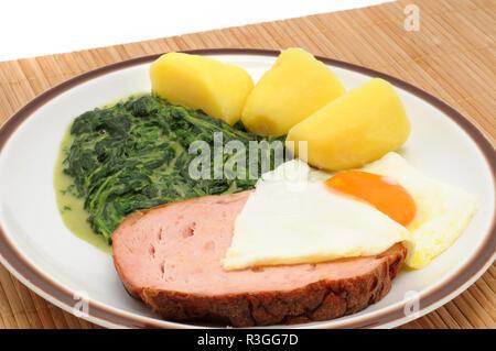 leberkaese with spinach / leberkaese with spinach - Stock Photo