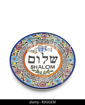 Antique Broken Ceramic Plate with Graphics and Hebrew Language Translation to word Shalom meaning to peace Isolated on White Background, Picture Conce - Stock Photo