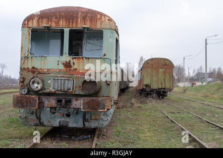 Old destroyed locomotives. Forgotten railway station in central europe. Season of the autumn. - Stock Photo