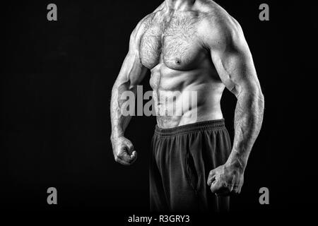 Muscle concept. Muscle torso with six pack abs of man, black and white. strong man isolated on black. Always in good shape. - Stock Photo