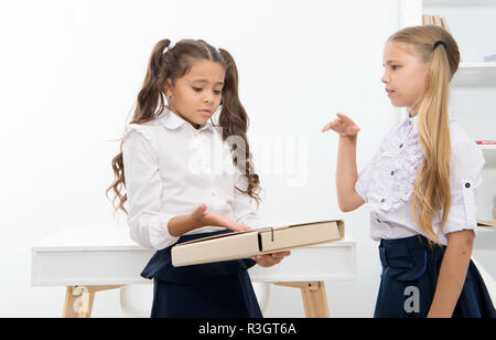 Little girls discuss problem on school day. little girls work on problem solution in classroom. - Stock Photo
