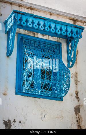 beautiful ornamental blue windows on a typical tunisian wall - Stock Photo