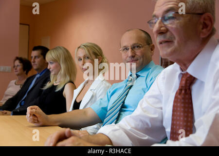 chef and his team in the round of talks - Stock Photo