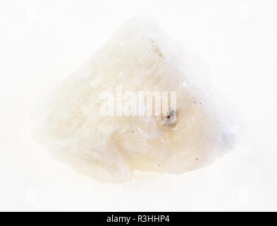 macro photography of natural mineral from geological collection - rough Barite stone on white background - Stock Photo