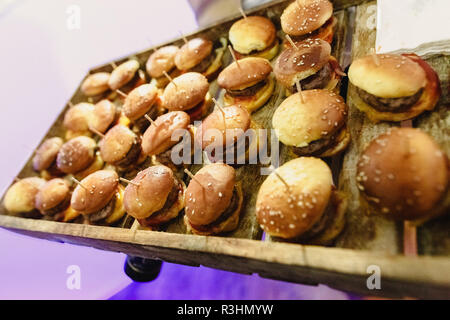 Tasty wedding appetizers served by waiters to the guests - Stock Photo