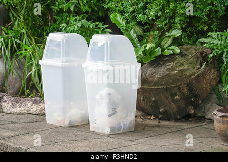 two white Recycle Bins In The Park, Environmental protection - Stock Photo