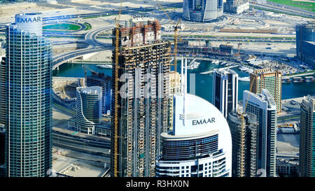 Standing on the Burj Khalifa tower in Dubai city and looking at the urban development in the downtown district on the east side.