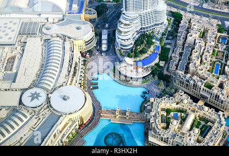 Dubai, United Arab Emirates - 31 October, 2018: Looking down at Dubai downtown district, luxury lifestyle apartments, palm trees and swimming pools. - Stock Photo