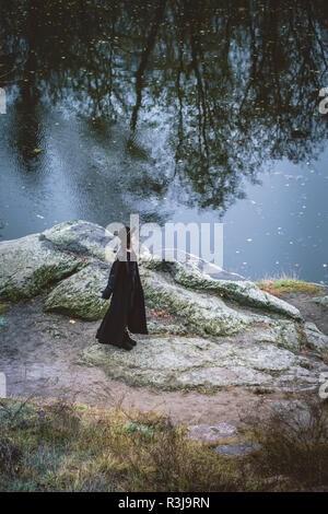 Girl on the rocks, view from above - Stock Photo