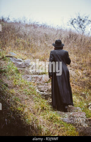 A woman climbs the stairs - Stock Photo