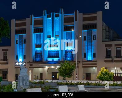 Holguin, Cuba - August 31, 2017: The Teatro Eddy Suñol building located in Calixto García Park illuminated with blue light in the evening. - Stock Photo