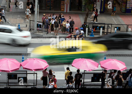 BANGKOK, THAILAND, MAY 29 2018, Blurry of moving cars drive through the crossing with the pedestrian zebra, the center of Bangkok. - Stock Photo