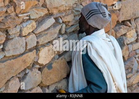 Pilgrim at the Great Temple of Yeha, Ethiopia - Stock Photo