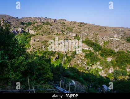 Goris Khndzoresk Hanging Bridge with Landscape of Ancient Cave Settlement - Stock Photo