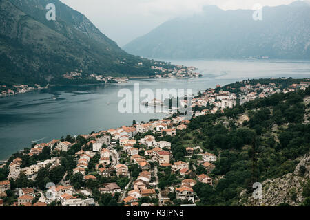 Aerial view of Kotor - a city on the Adriatic coast in Montenegro. One of the most beautiful coastal cities of Montenegro. Near a beautiful mountain landscape. - Stock Photo