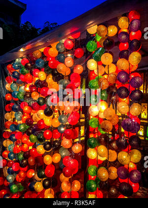 Verticle hanging lights at the Night bazaar in Chiang Mai. - Stock Photo