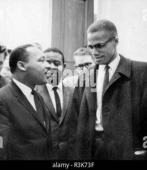 MARTIN LUTHER KING (1929-1968) American civil rights leader  at left with Malcolm X ion 26 March 1964. Photo: Library of Congress. - Stock Photo