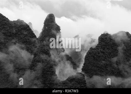 Karst hills in morning mist, Guilin, Guangxi Province, China - Stock Photo