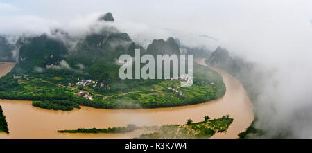 Karst hills with Li River in morning mist, Guilin, Guangxi Province, China - Stock Photo